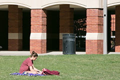 Photo of student studying on campus. Links to Gifts by Estate Note.